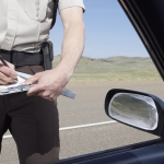highway patrolman writing ticket